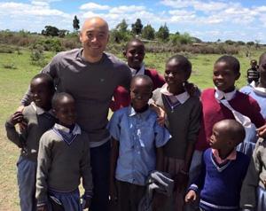 Tom with School Children